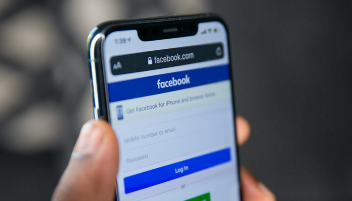 Mobile phone showing Facebook